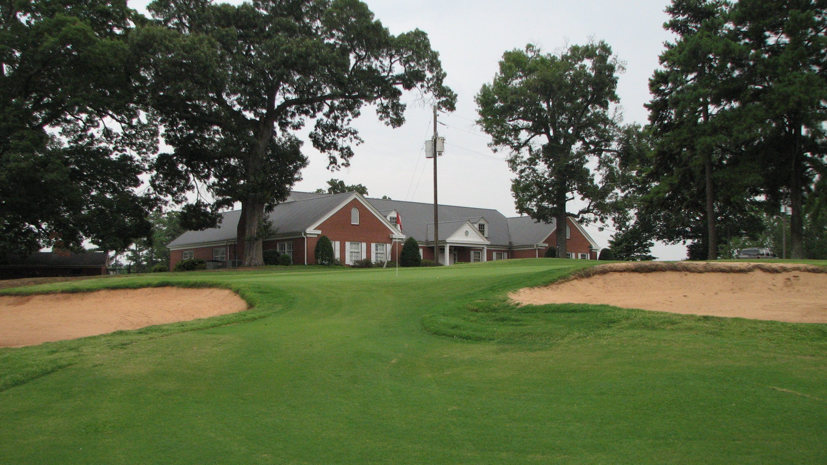 green with clubhouse in the background